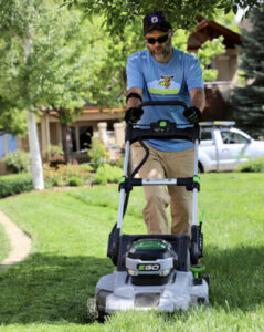 working outside with lawn mower
